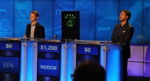 IBM's Watson computer system competes against Ken Jennings and Brad Rutter in a practice Jeopardy! match in 2011. (Image credit: IBM)