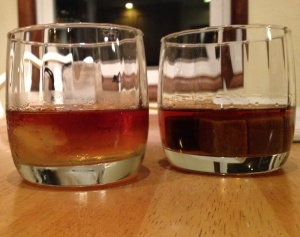 One glass of Knob Creek (on the right) with ice, one glass (on the left) with whiskey stones.